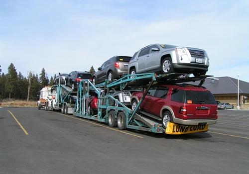 Chiloquin Towing: Loaded car hauler in need of repair