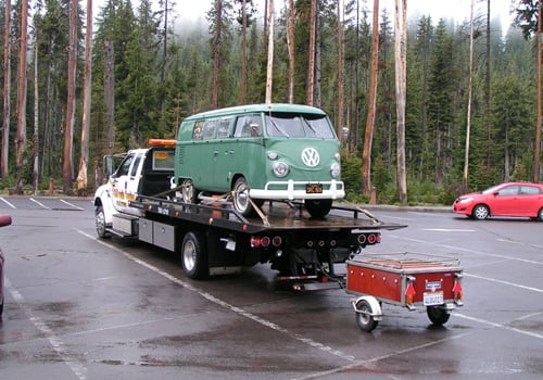 Chiloquin Towing: antique VW bus with trailer in need of repairs