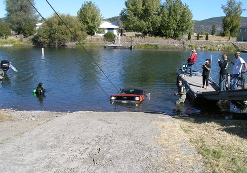 Chiloquin Towing: Totally submerged in the river, complete with trailer