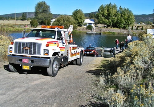 Chiloquin Towing: Pickup and trailer emerging from the river