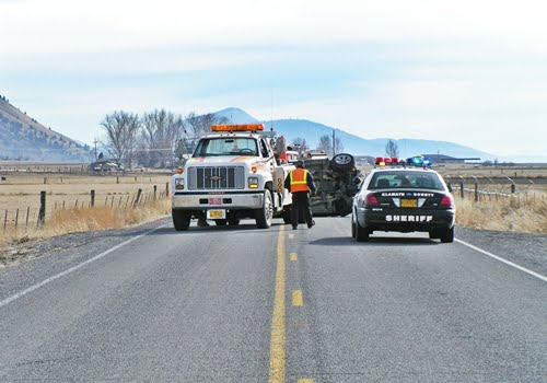 Chiloquin Towing: vehicle on its side blocking roadway