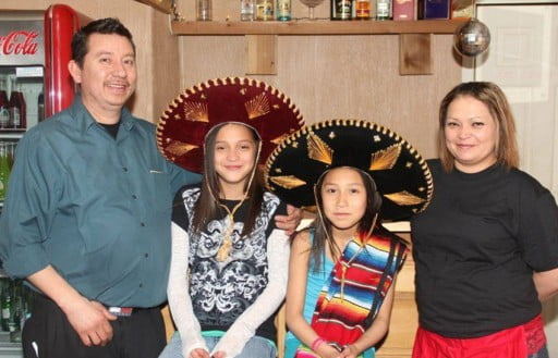Rigoberto and Marina Hernandez and girls, owners of El Rodeo restaurant in Chiloquin