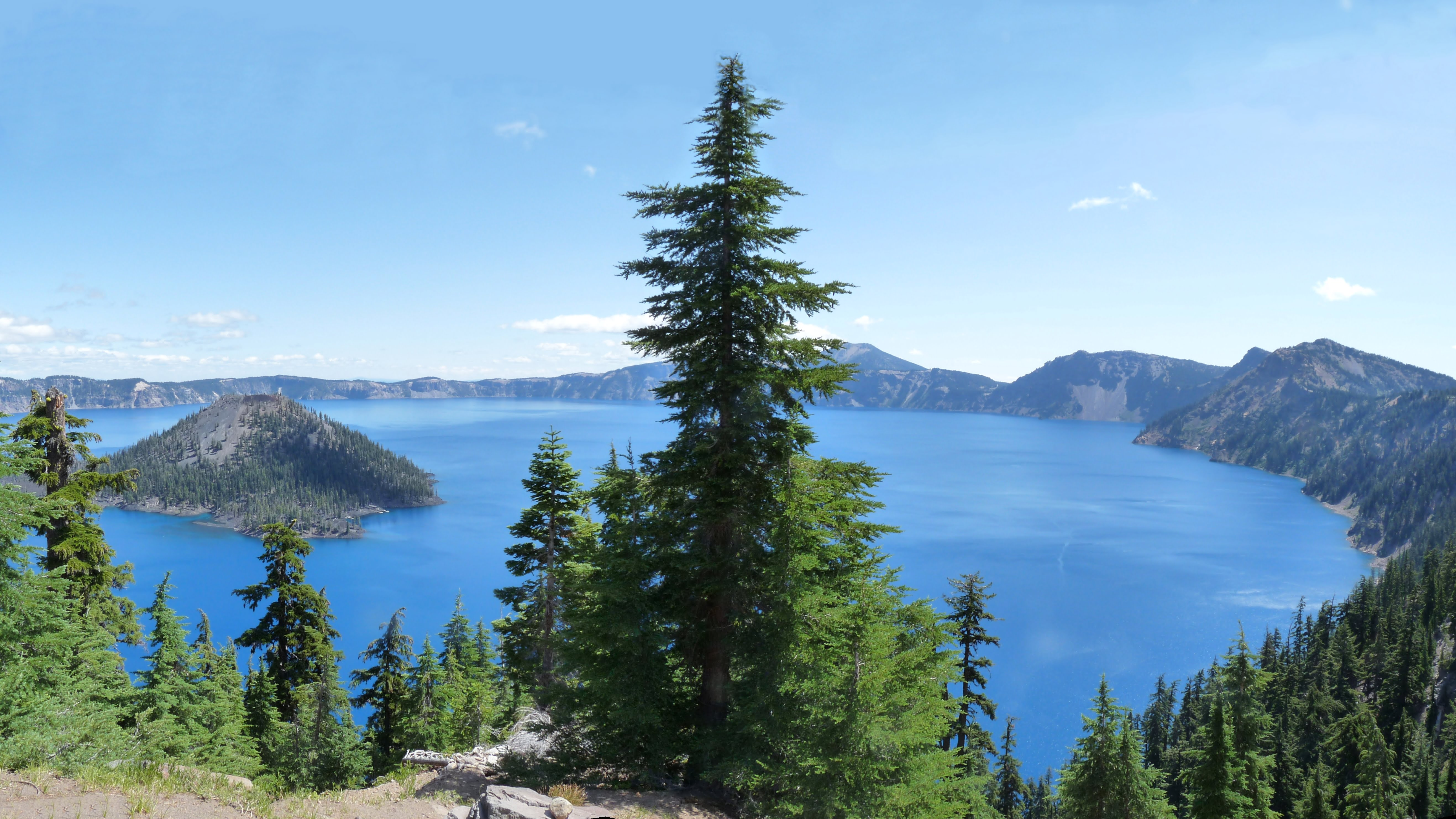 The classic view of Wizard Island in a spectacularly blue Crater Lake.