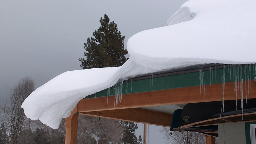 Wind-sculptured snow is a reminder that those canoes will not be put to use for some time yet.